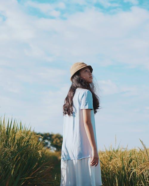Woman Wearing A Dress Standing Besides Grass