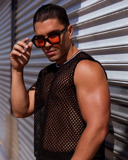Man Wearing Black Tank Top and Black Framed Sunglasses