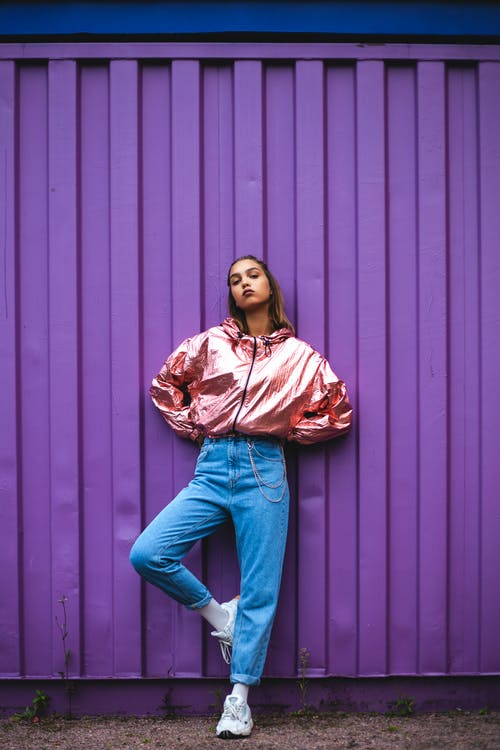 Woman In Pink Zip-up Jacket And Blue Denim Jeans