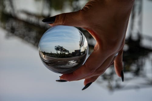 Free stock photo of glass ball, hand, industrial plant, seascape