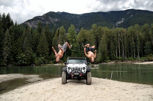 Gratis stockfoto met achterwaartse salto, actie energie, auto, automobiel