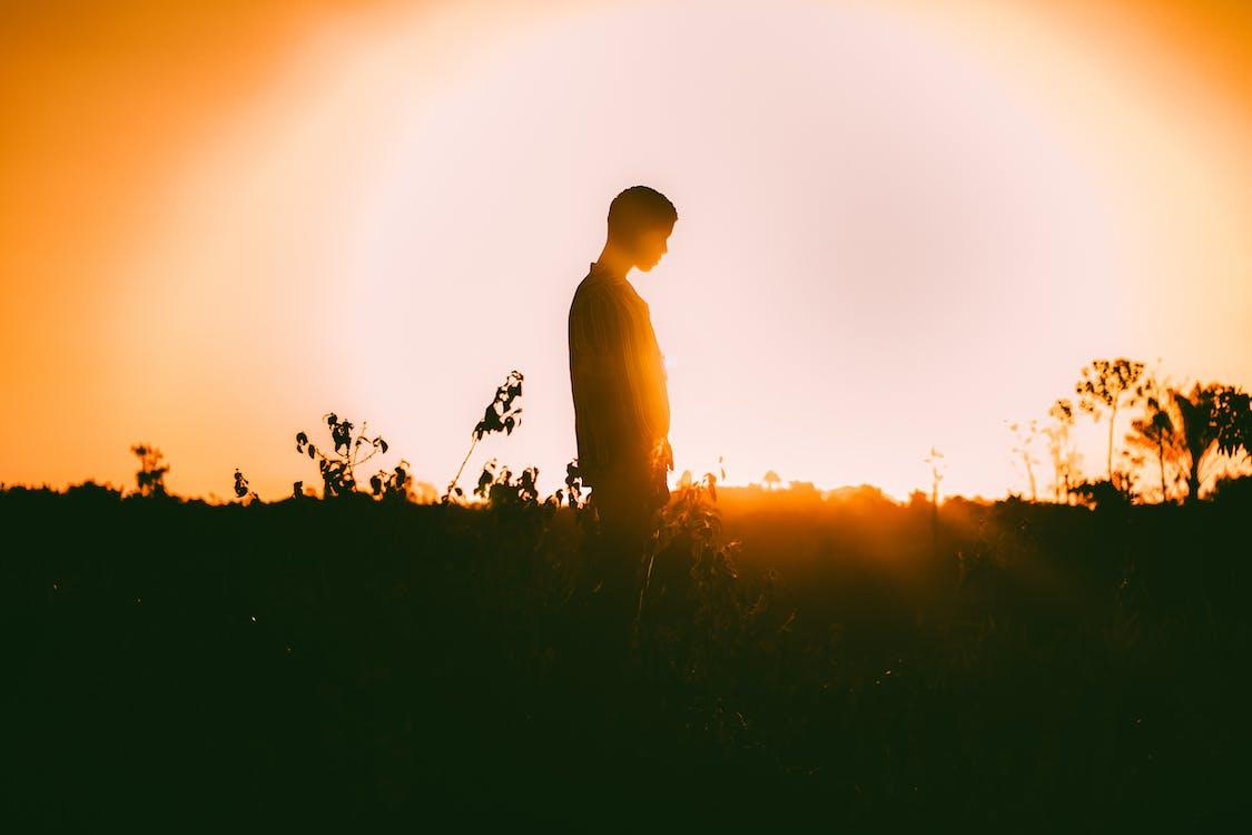 Man Standing On Field