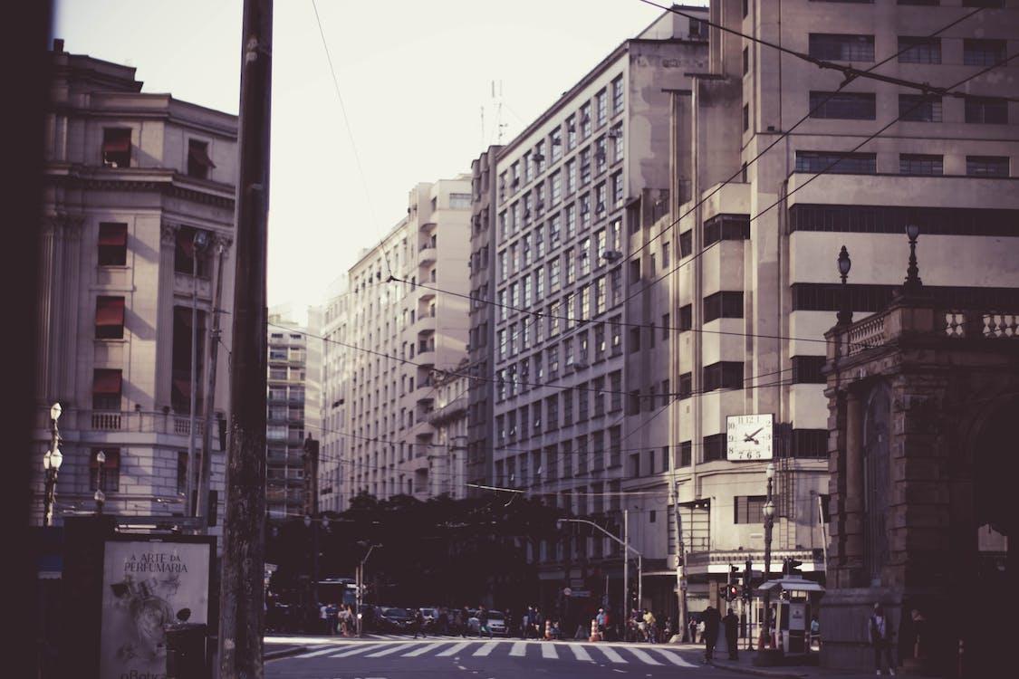 Grey Asphalt Road Near Buildings