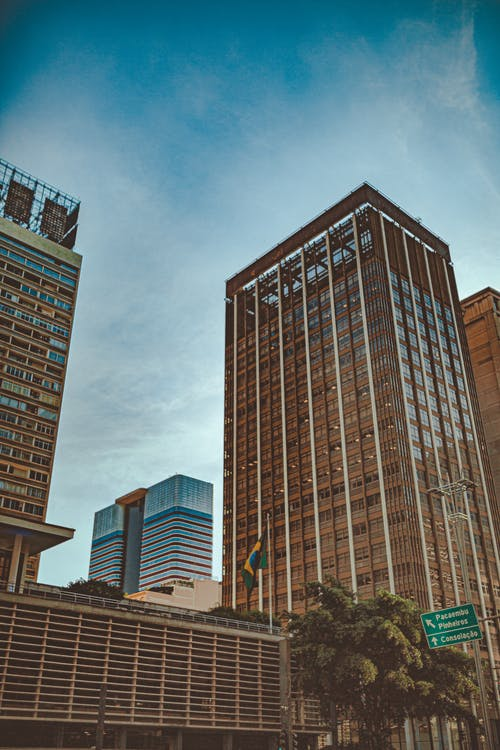 Photo of High-rise Buildings Under Clear Sky