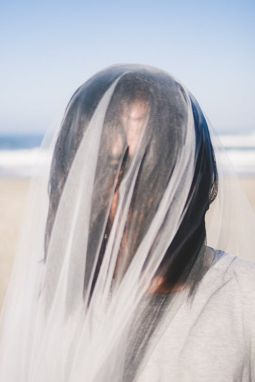 Woman Covered With White Veil