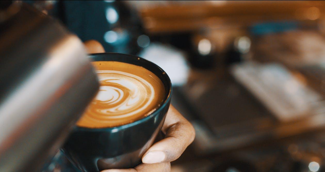 Coffee Latte in Black Ceramic Cup