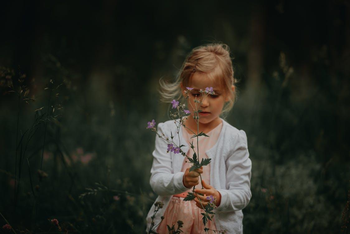 Girl Holding Flowering Plants