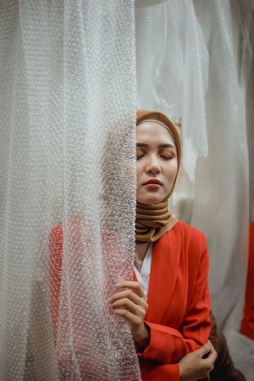 Woman Wearing Orange Long-sleeved Shirt and Brown Hijab