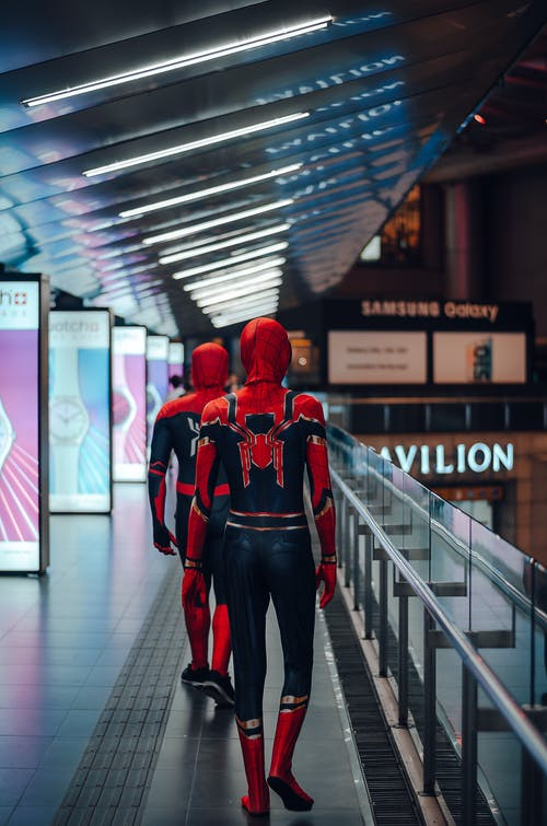 People Wearing Spider-man Adult Costume Walking on Train Station