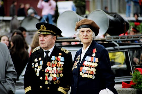 Shallow Focus Photo of Two Persons Wearing Military Uniform