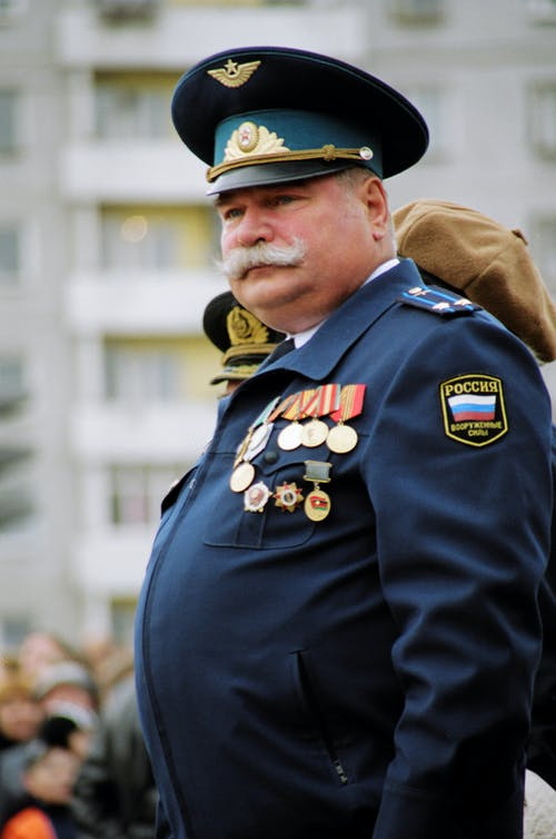 Man Wearing Blue Uniform