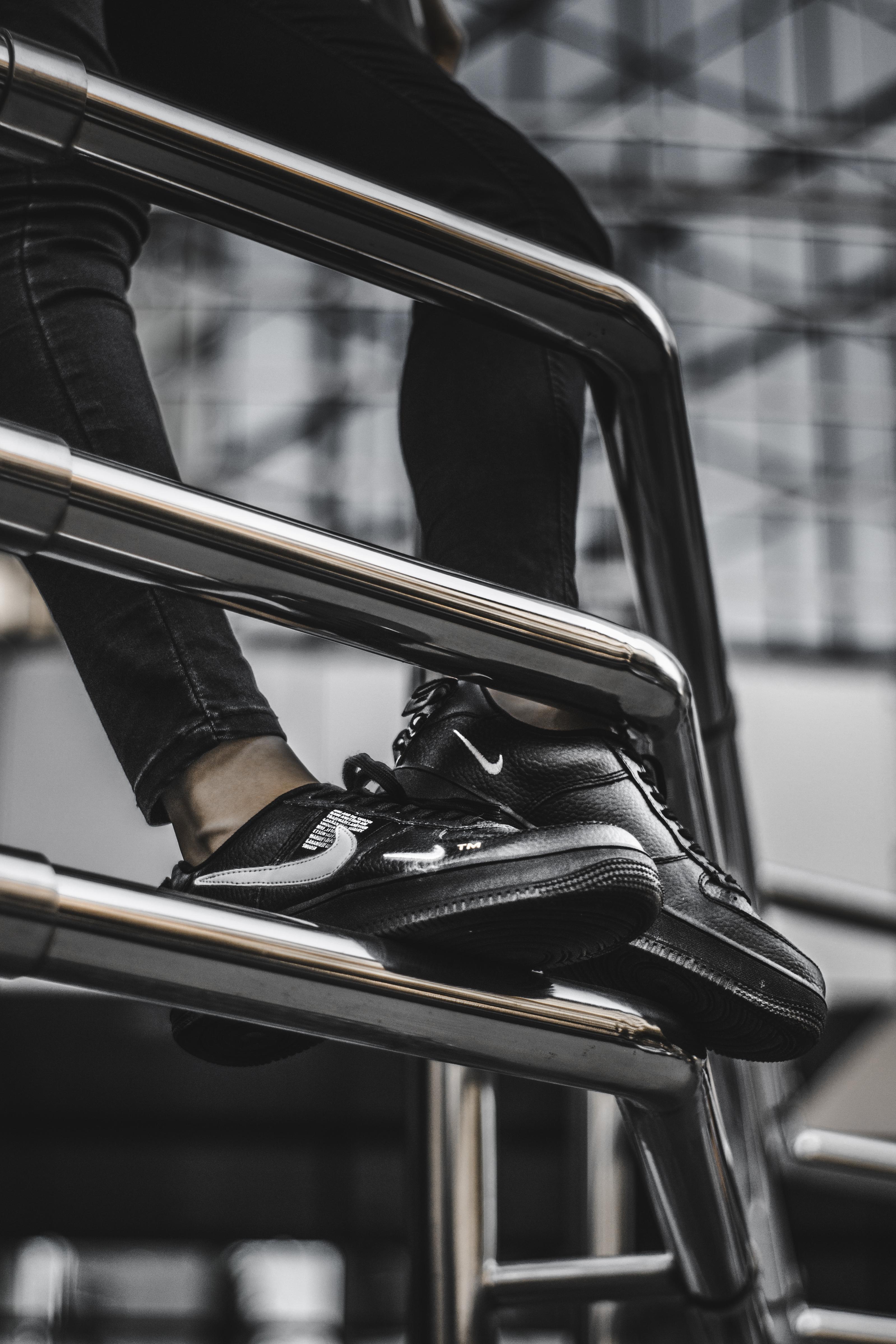 person wearing black low top sneakers