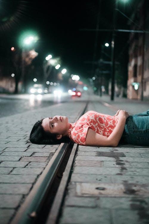 Woman Lying on Sidewalk
