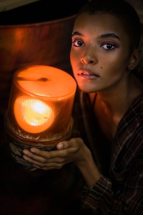 woman Holding Lamp