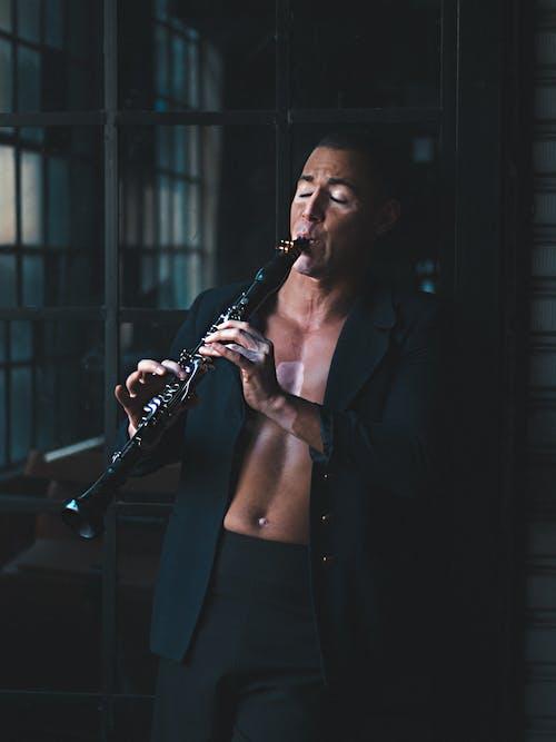 Man Holding Flute