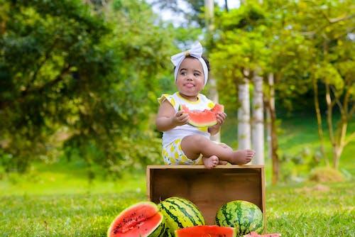 Baby Holding Watermelon Slice