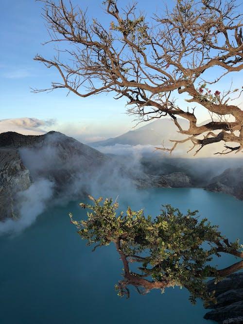 Gratis lagerfoto af bjerg, blåt vand, dagslys, damp