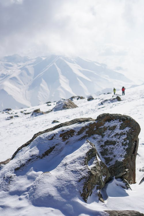 People on Snow Capped Mountain