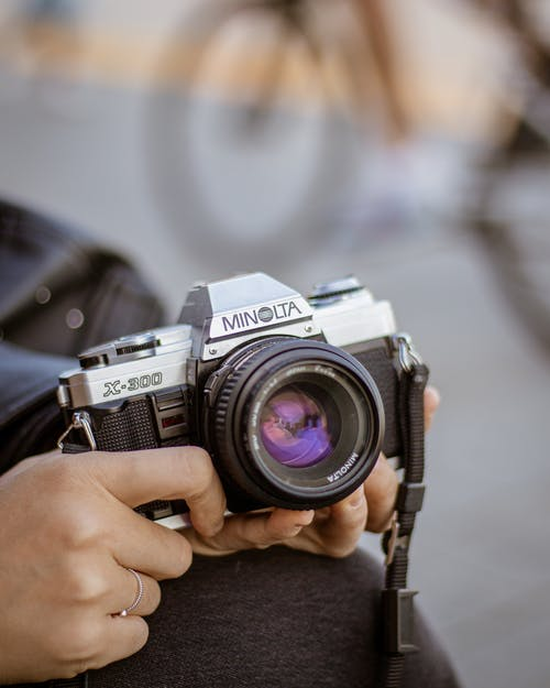Person Holding Black Camera