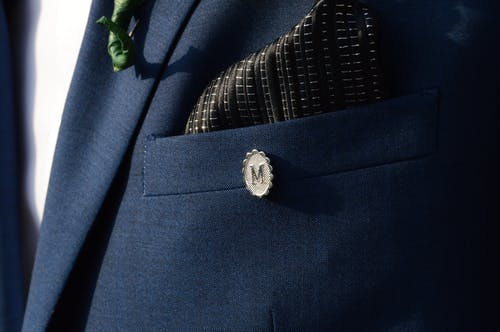 Silver-colored M Lapel Pin