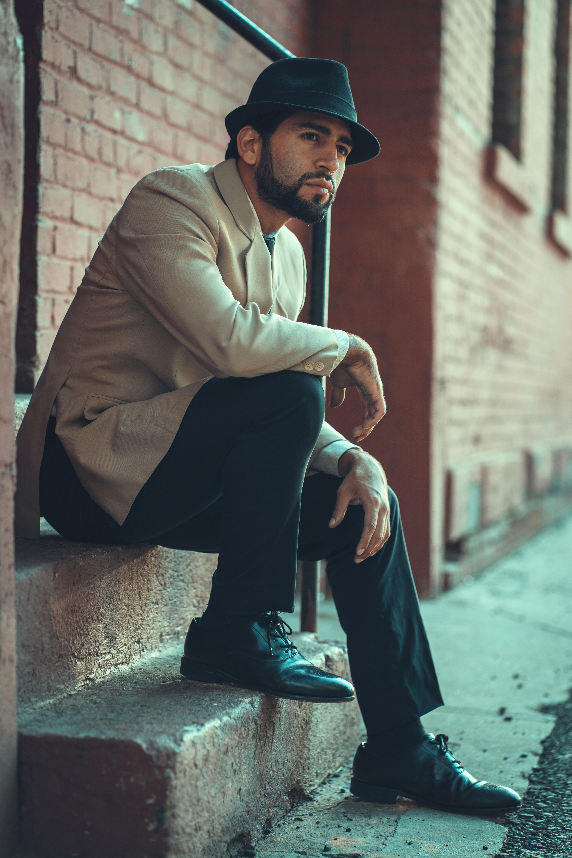 Photo of Man Sitting on Stairway