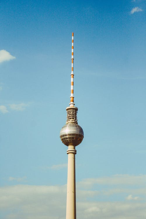 Berliner Fernsehturm Tower in Berlin, Germany Under Blue and White Skies