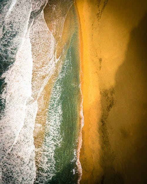 Aerial Photography of Waves Hitting Seashore