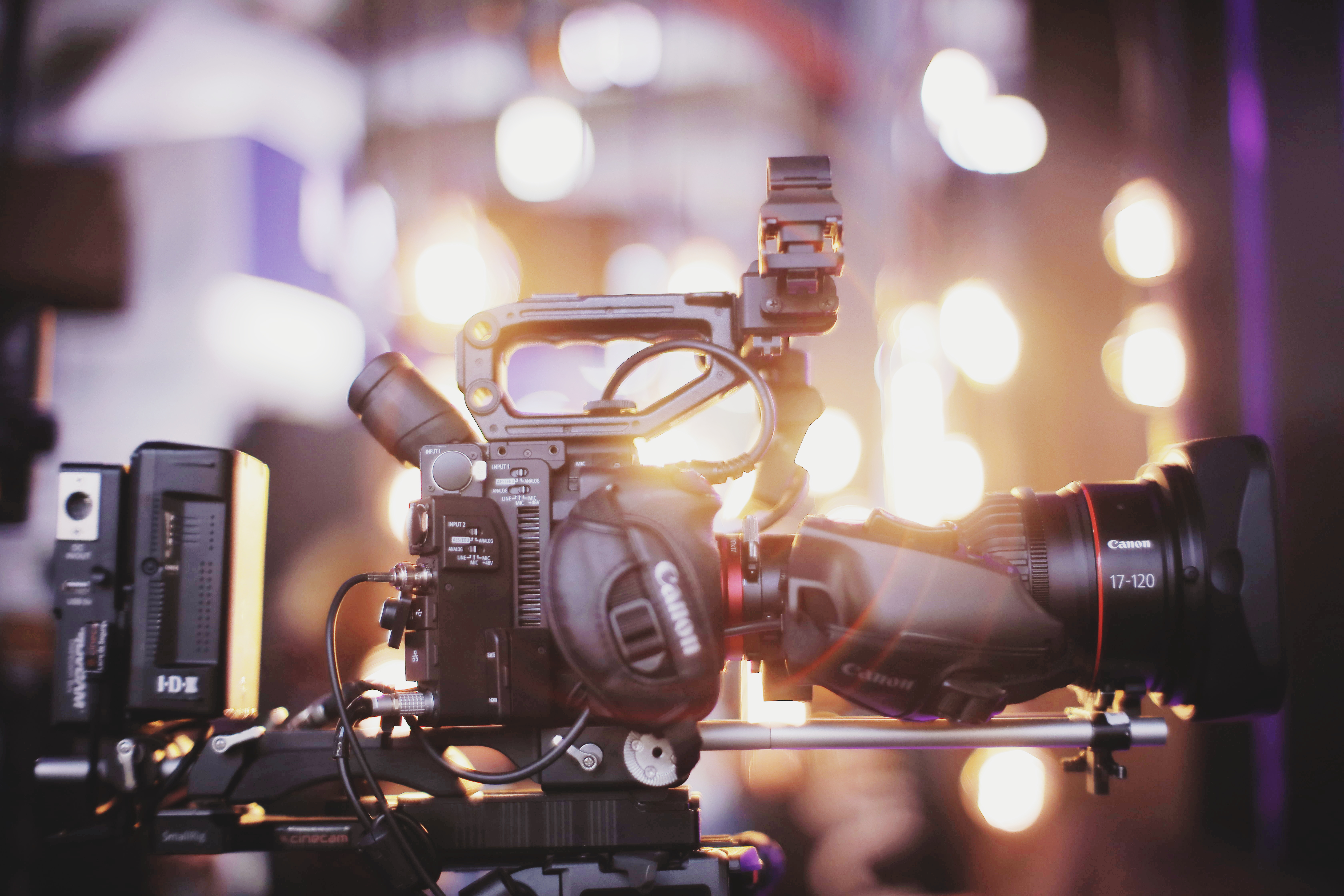 Photo of Black Canon Dslr Camera With Tripod