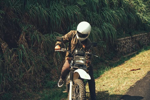 Free stock photo of grass, helmet, jacket, motorcycle