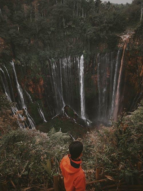 Man Facing Waterfalls