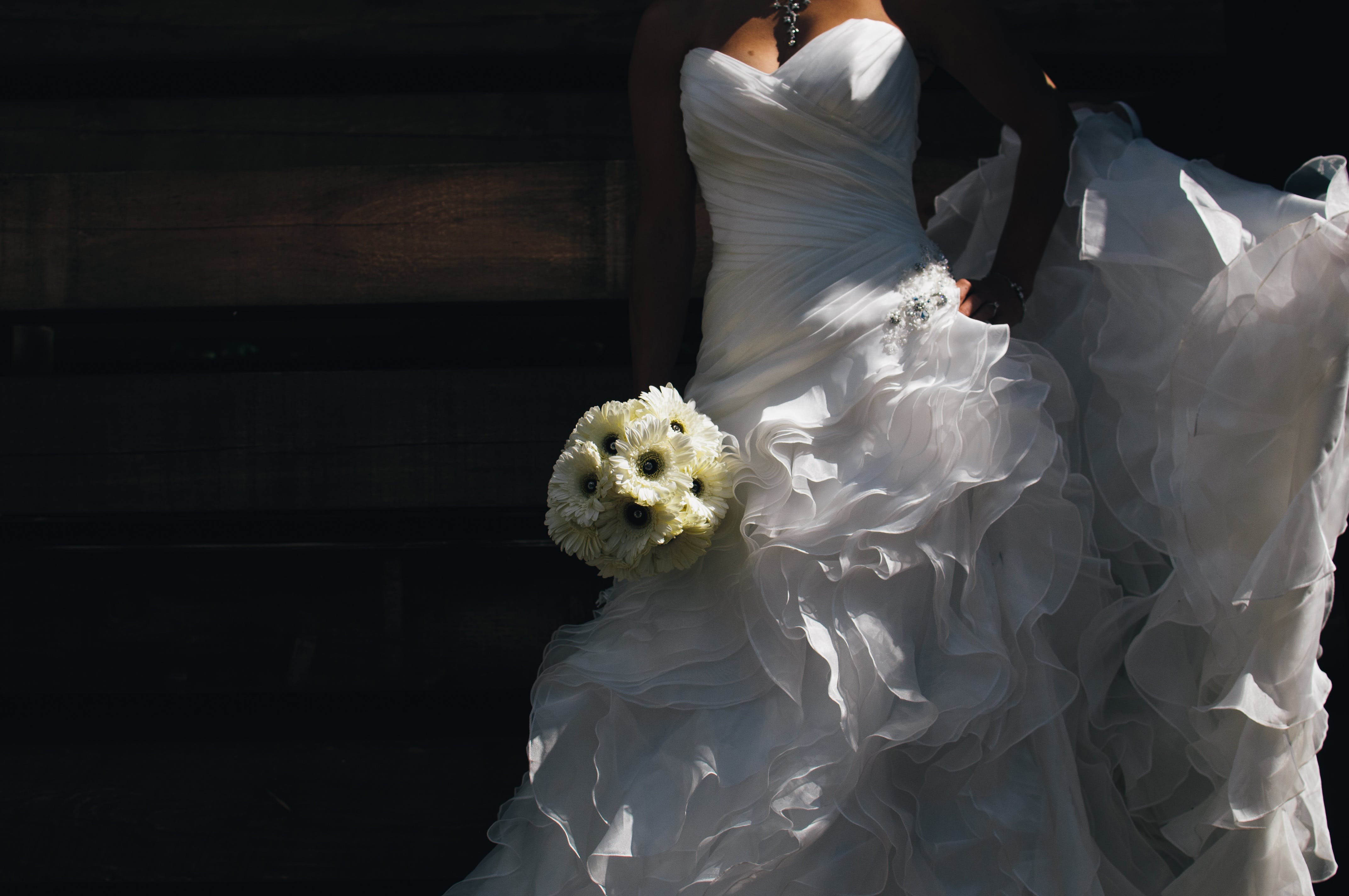 Woman in White Wedding Gown Holding Bouquet