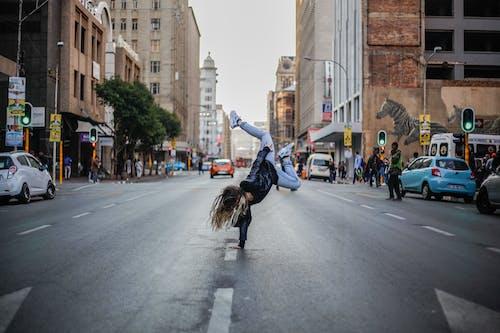 Woman Breakdancing on Street