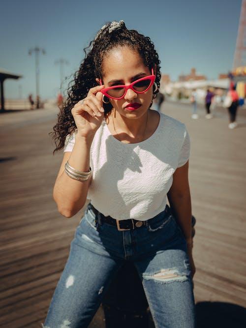 Photo Of Woman Touching Her Sunglasses