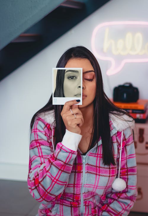 Photo Of Woman Holding A Photo