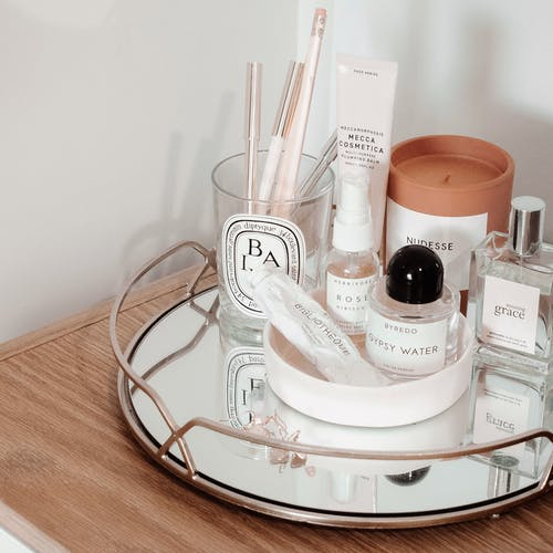 Makeup Set With Tray Beside Wall