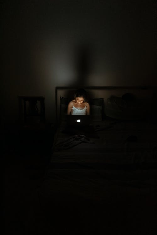 Woman Facing Macbook