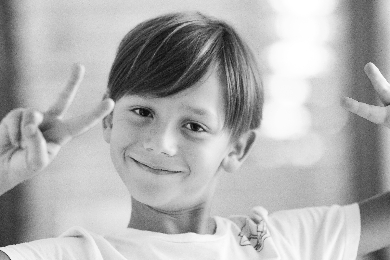 Free stock photo of black and white, boy, portrait, smile