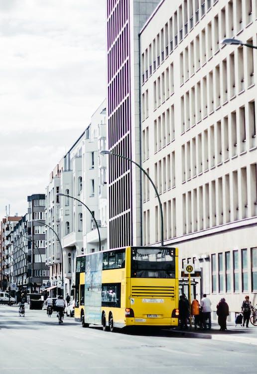 People Near Yellow Double-decker Bus