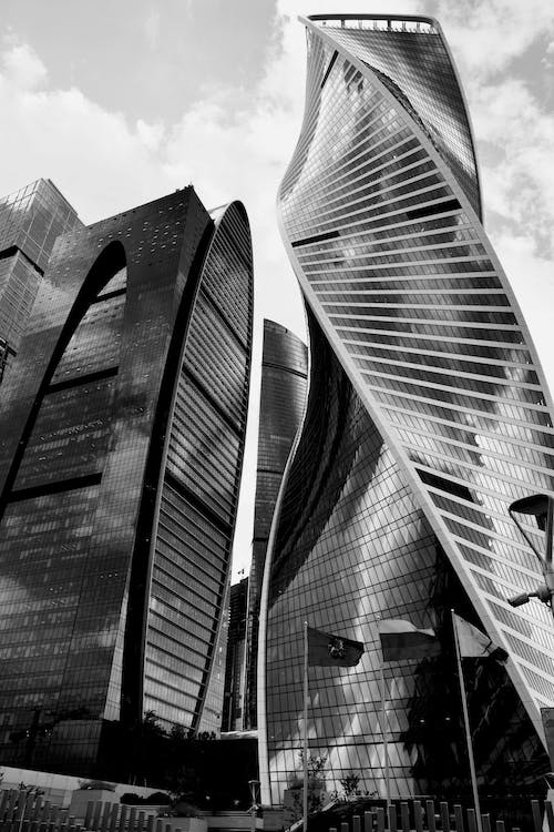 Grayscale Photo of Glass Buildings