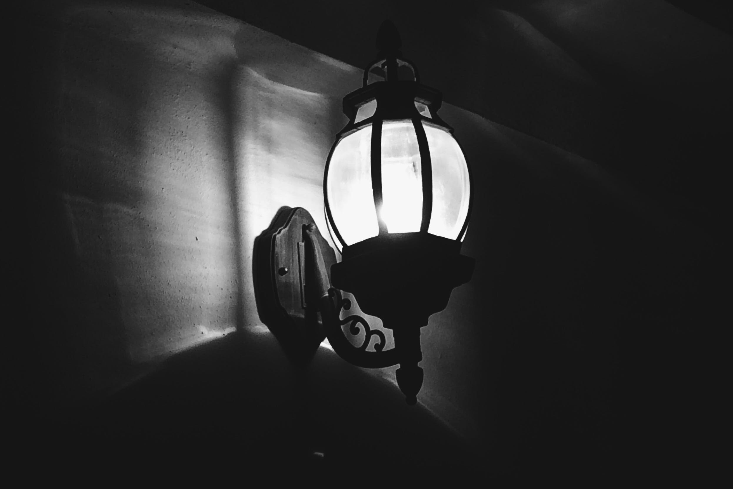 Grayscale Photography of Sconce