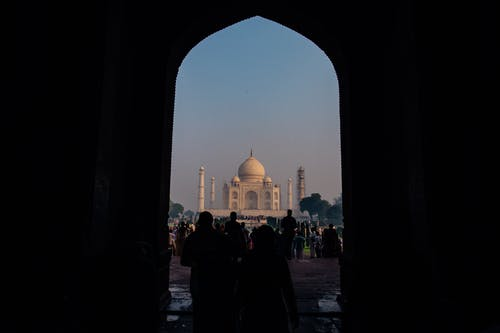 Silhouette of People Walking Towards Taj Mahal