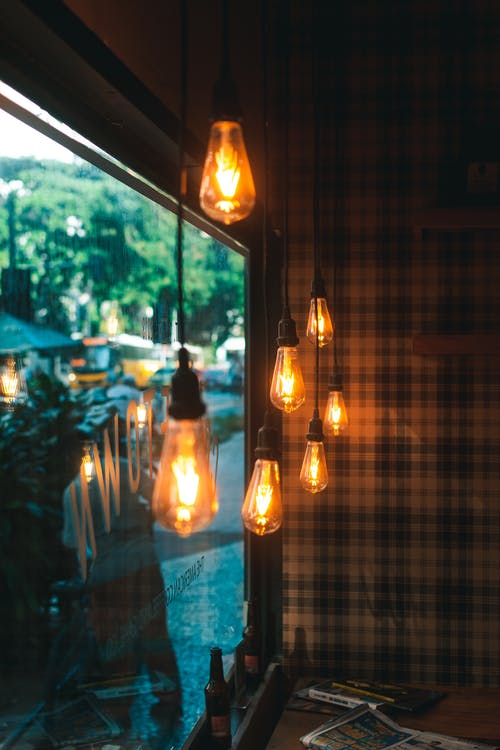 Free stock photo of checkered, coffee shop, colors, desk lamp