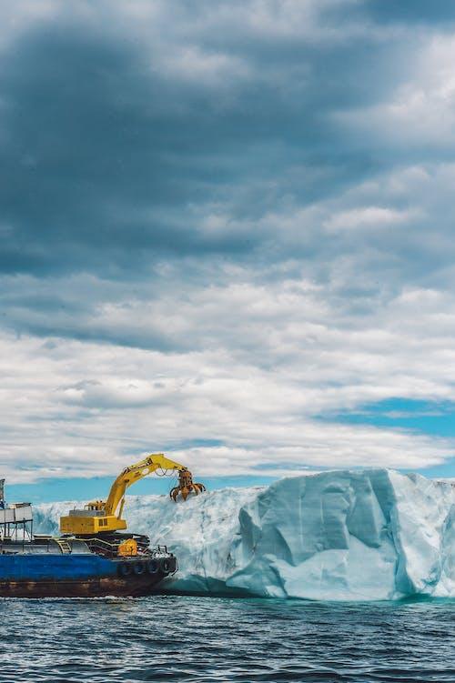 Yellow Excavator Beside Glacier