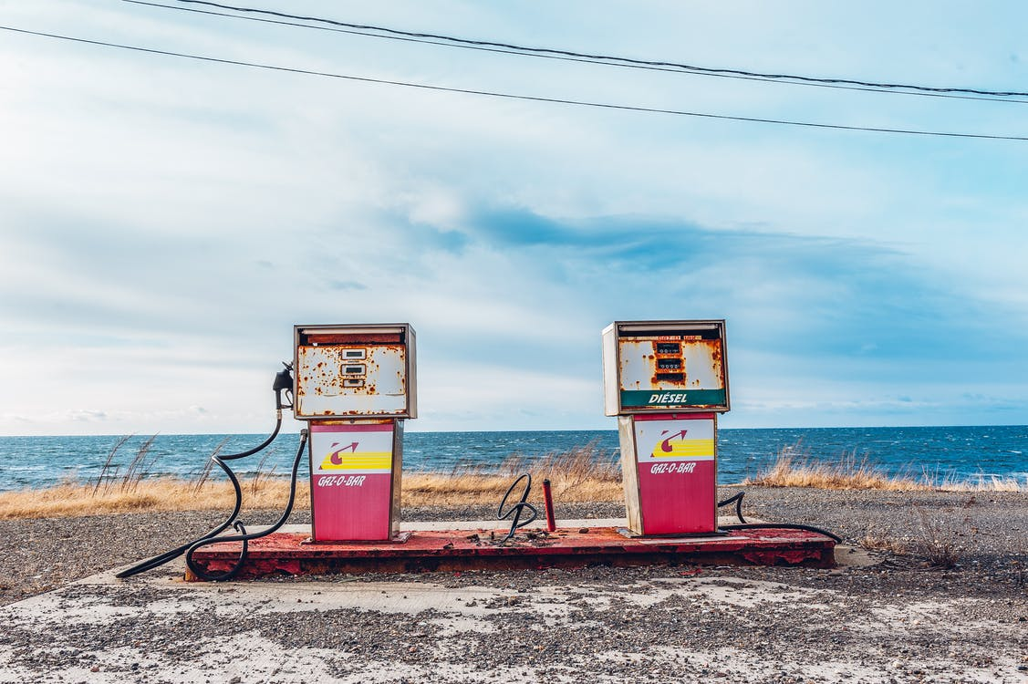 White and Pink Gasoline Station Near Ocean