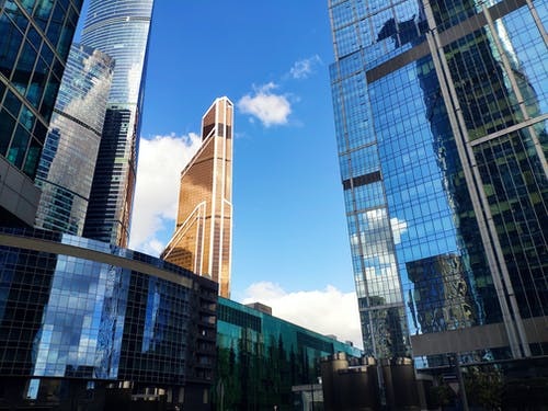 Low Angle Photo of Commercial Glass Buildings Under Clear Sky