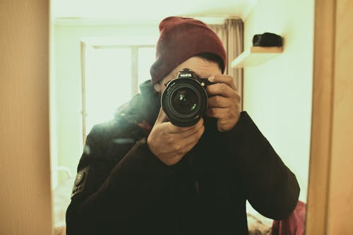 Man  Taking  Photo with a Nikon Camera