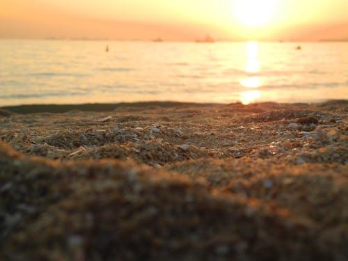 Foto profissional grátis de areia, litoral, pôr do sol