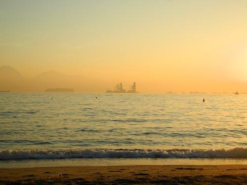 Foto profissional grátis de balsa, mar, pôr do sol