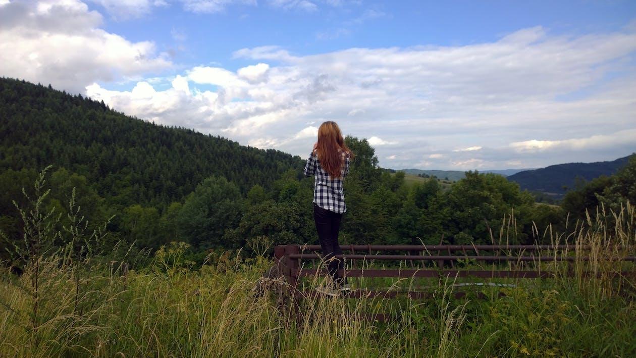 Woman Standing Near Grass