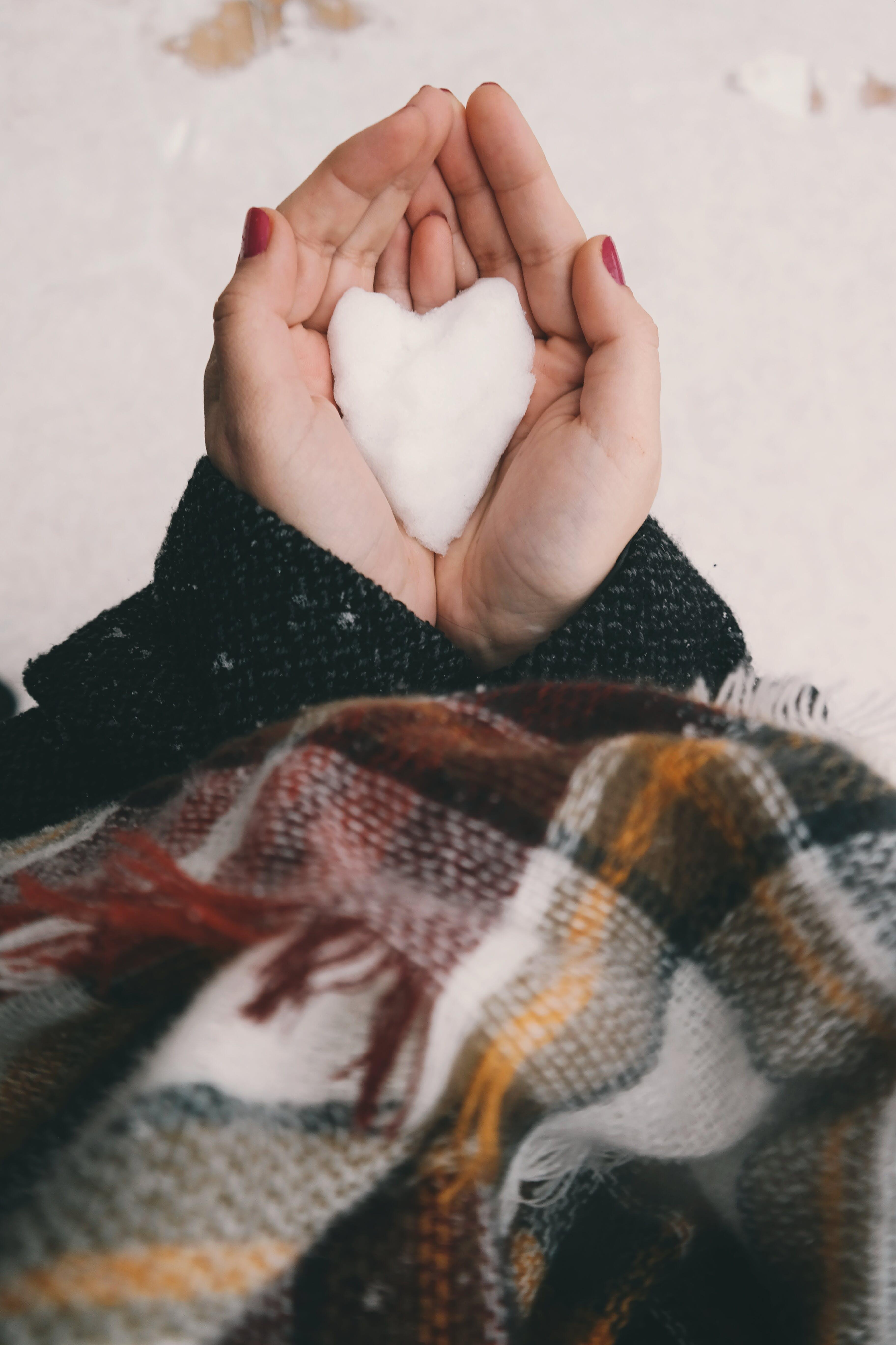 Person Holding White Heart Decor